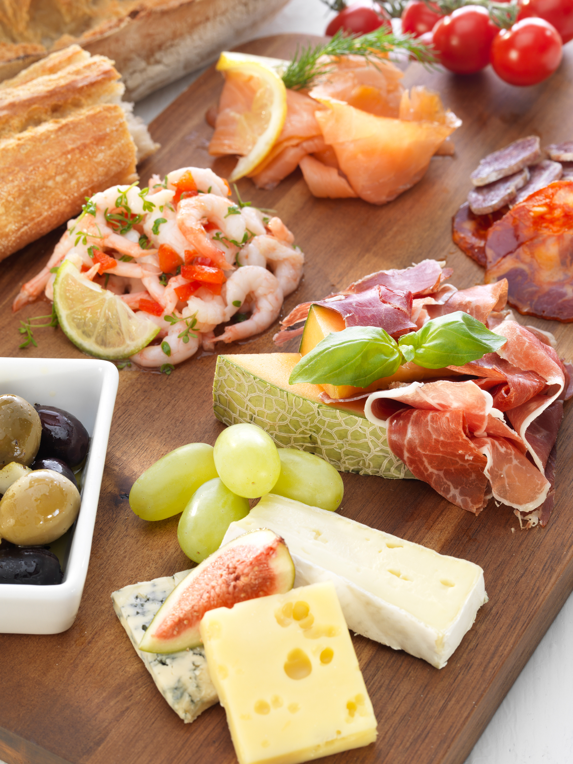 tapas on a wood plate